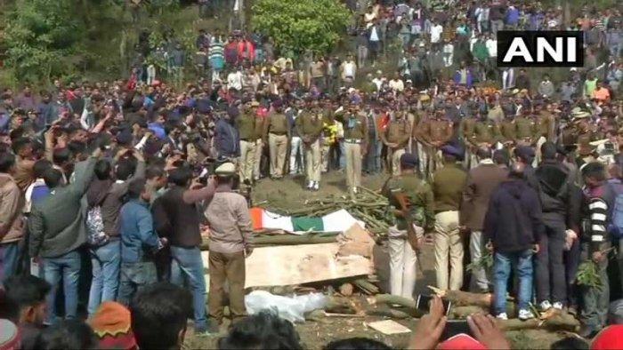 "Raj's brother, Baldev Singh, lit the funeral pyre as the villagers kept chanting ""Shaheed Tilak Raj amar rahe"". Anti-Pakistan slogans were also raised. (Image: ANI/Twitter)"