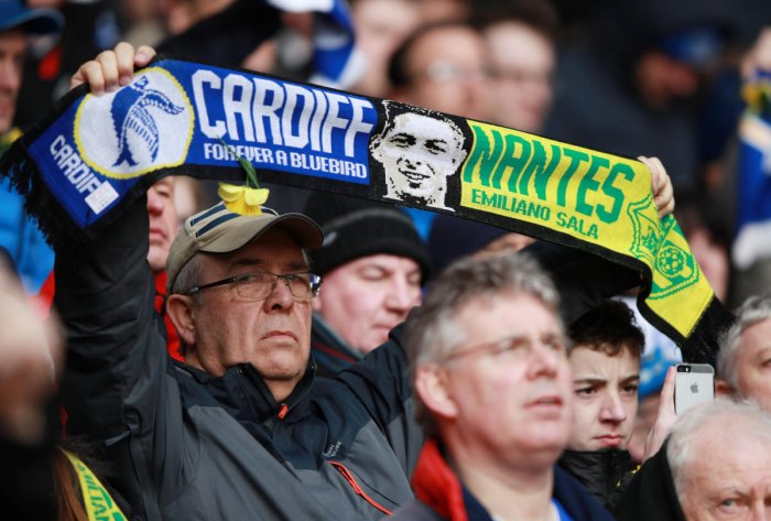 GOODBYE: A fan holds a scarf in remembrance of Emiliano Sala before the match between Southampton and Cardiff City on Saturday. REUTERS