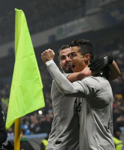 RISING HIGH: Juventus' Cristiano Ronaldo (right) celebrates with Federico Bernardeschi after scoring against Sassuolo on Sunday. REUTERS