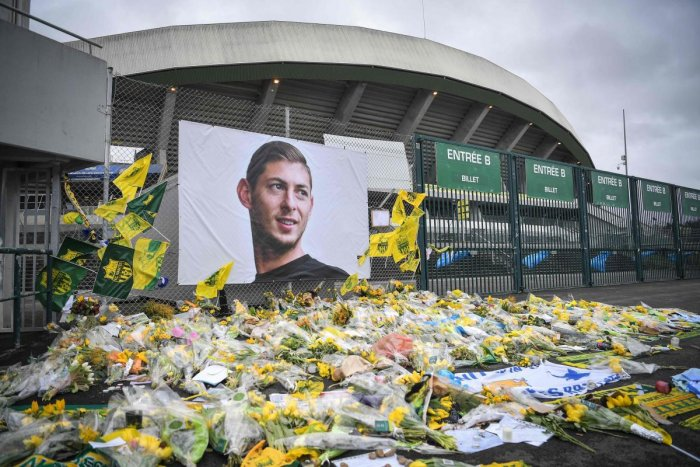 Flowers are displayed in front of the portrait of Argentinian forward Emiliano Sala at the Beaujoire stadium in Nantes, France. (AFP File Photo)