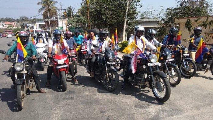 Karnataka Kavalu Pade activists take out a bike rally in Kushalnagar on Friday.