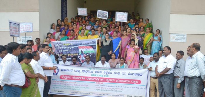Teachers stage a protest outside the DC's office in Madikeri on Saturday.