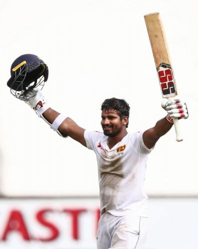 INCREDIBLE: Sri Lanka's Kusal Perera celebrates after powering his side to a sensational win over South Africa on Saturday. AFP