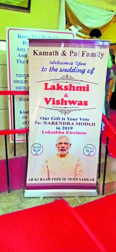 The banner seeking vote for Prime Minister Narendra Modi put up at the marriage of Lakshmi and Vishwas in Mangaluru.
