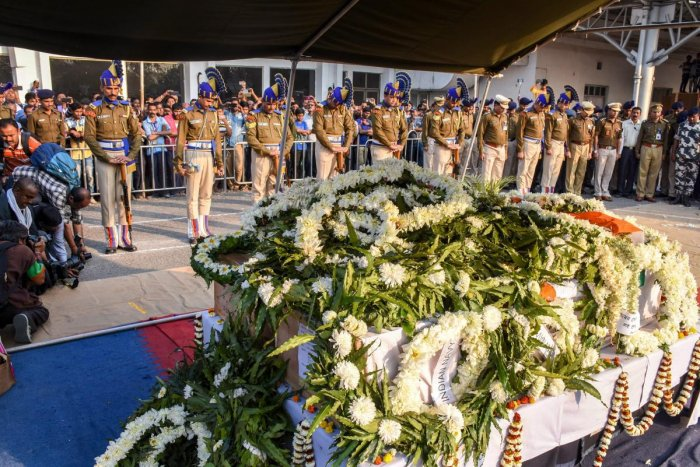 Central Reserve Police Force personnel pay Guard of Honour to slain CRPF Jawan Bablu Santra, who lost his life in the Pulwama terror attack, at Airport, in Kolkata, Saturday, Feb. 16, 2019. (PTI Photo)