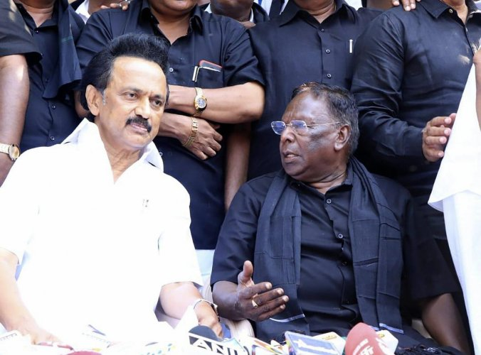 DMK President MK Stalin speaks with Puducherry Chief Minister V Narayanasamy during a dharna outside the office of Puducherry Lt Governor Kiran Bedi on the fifth day of protest, in Puducherry, Sunday, Feb 17, 2019. (PTI Photo)