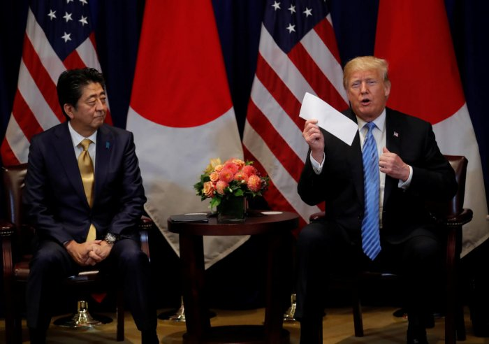 U.S. President Donald Trump shows a letter Trump said he received from North Korea's leader Kim Jong Un during a bilateral meeting with Japan's Prime Minister Shinzo Abe on the sidelines of the 73rd session of the United Nations General Assembly in New Yo