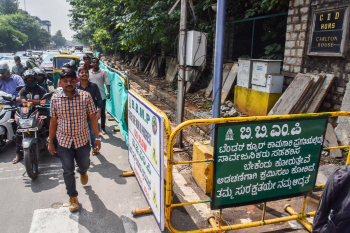 Pedestrians suffer to walk, due to Tender SURE work is started at Place Road, in front of CID Head Quarters in Bengaluru. Photo by S K Dinesh