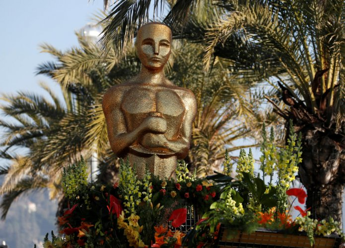 An Oscar statue is seen during the flower parade as part of the Carnival of Nice, France. (Reuters Photo)