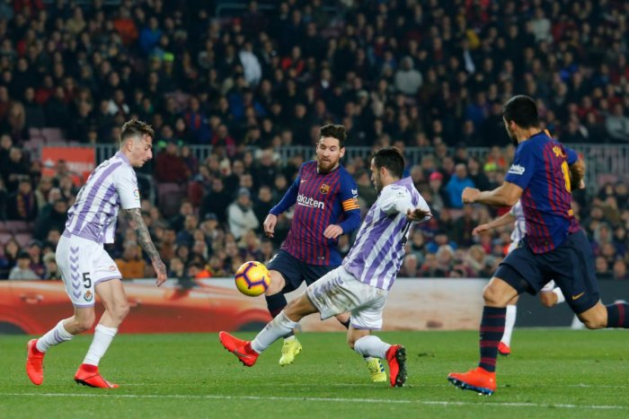 Barcelona's Argentinian forward Lionel Messi (2L) and Barcelona's Uruguayan forward Luis Suarez (R) vie for the ball with Real Valladolid's Spanish defender Fernando Calero and Real Valladolid's Spanish defender Kiko Olivas during the Spanish League footb