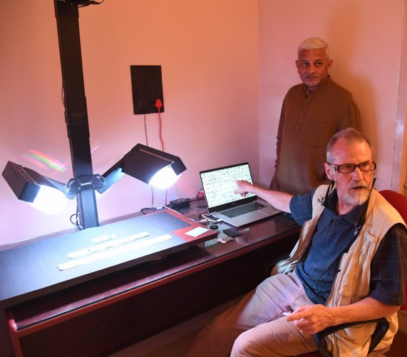 Ken Boydaton from the US explains about restored palm-leaf manuspricts as his collaborator P R Mukund looks on at a lab in Bengaluru. dh photo