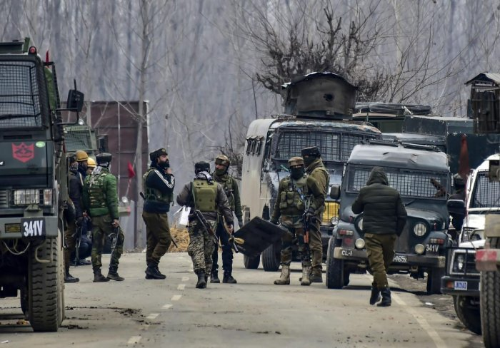 Security forces personnel arrive for the reinforcement during a gunbattle with the militants in which the top commander of the Jaish and Lethpora attack mastermind Kamran was killed along with his associate Hilal Ahmad, a local recruited by the terror group, at Pinglan area of Pulwama in south Kashmir, Monday, February 18, 2019. Four Army personnel, including a Major, were also martyred in the encounter. (PTI Photo)