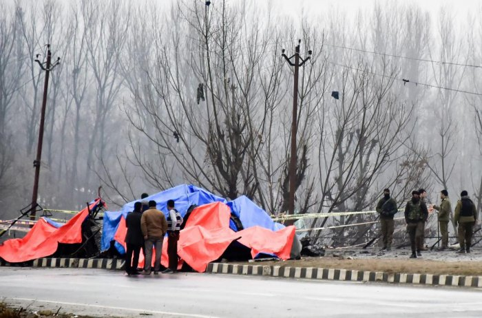 Security agencies inspect the site of a suicide bomb attack at Lethpora area, in Pulwama district of south Kashmir. (PTI Photo)