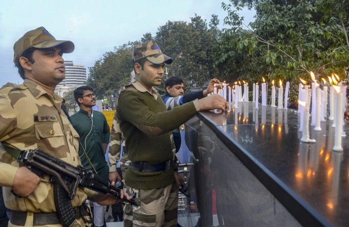 CISF members light candles to pay tribute to CRPF soldiers who lost their lives in Pulwama terror attack, at Connaught Place in New Delhi. PTI