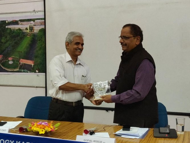 Prof Umamaheshwar Rao, director of NITK, Surathkal, (left) presents a memento to retired IGP Gopal Hosur, who spoke on the role of intelligence in good governance at NITK on Monday.