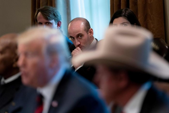 In this file photo, advisor Stephen Miller listens while US President Donald Trump speaks during a meeting on border security in the Cabinet Room of the White House in Washington, DC. AFP