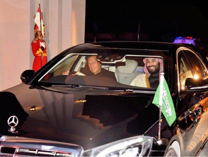 Pakistani Prime Minister Imran Khan (L) drives a vehicle as he receives Saudi Arabia's Crown Prince Mohammed bin Salman on his arrival at Pakistan Air Force (PAF) Nur Khan Base in Rawalpindi, Pakistan February 17, 2019. (Press Information Department (PID)/Handout via REUTERS)