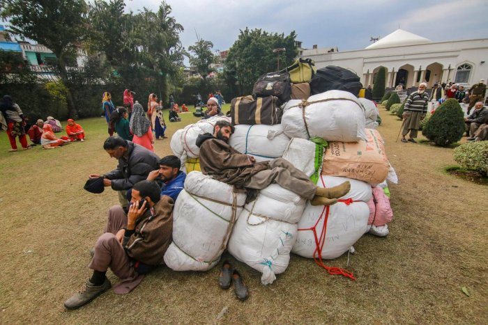 Stranded Kashmiri passengers rest as they wait for the highway to open at Makka Masjid in Bhatindi area of Jammu, Monday, Feb 18, 2019. The curfew was imposed Friday following the violent protests over the Pulwama terror attack. (PTI Photo)