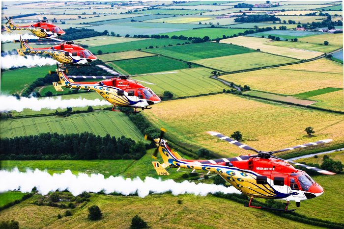 The Sarang team, with four helicopters, creates spectacular aerobatic formations.