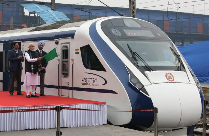 In this photo taken on February 15, 2019, Indian Prime Minister Narendra Modi (2nd L) flags off India's first semi-high speed express train Vande Bharat Express at New Delhi Railway Station. - India's first semi-high speed express train February 16 broke