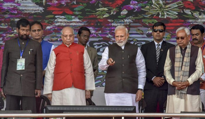 Prime Minister Narendra Modi flanked by Bihar Governor Lalji Tandon and Chief Minister Nitish Kumar during the inauguration and foundation stone-laying ceremony of various development projects, in Begusarai. Also seen is Union Minister Ram Vilas Paswan. (