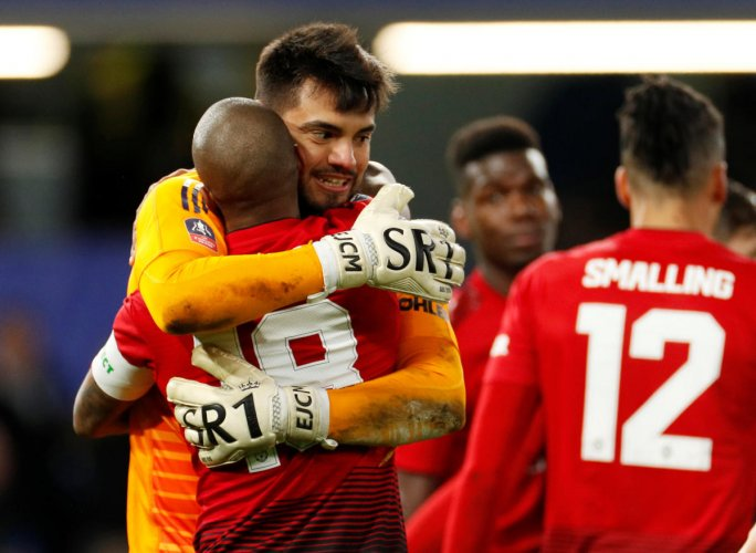 - Chelsea v Manchester United - Stamford Bridge, London, Britain - February 18, 2019 Manchester United's Sergio Romero celebrates with Ashley Young after the match Action Images via Reuters