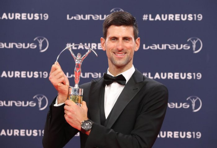 Novak Djokovic with the Sportsman of the Year award. AFP