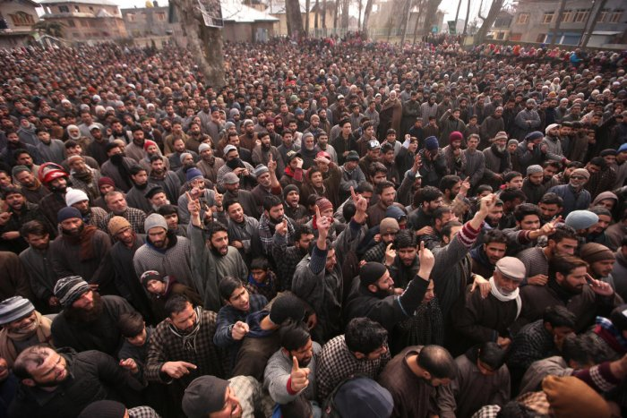 People shout slogans before offering funeral prayers of Mushtaq Ahmad, a civilian, and Hilal Ahmad Naikoo, a suspected militant, who according to local media were killed during a gun battle between suspected militants and Indian security forces on Monday, in Pinglena village in south Kashmir's Pulwama district February 19, 2019. (REUTERS)