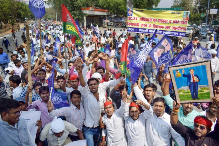 Bhim Sena and Samajwadi Party supporters raise slogans during 'Bharat Bandh' call by Dalit organisations against the alleged 'dilution' of Scheduled Castes/Scheduled Tribes act, in Moradabad. PTI
