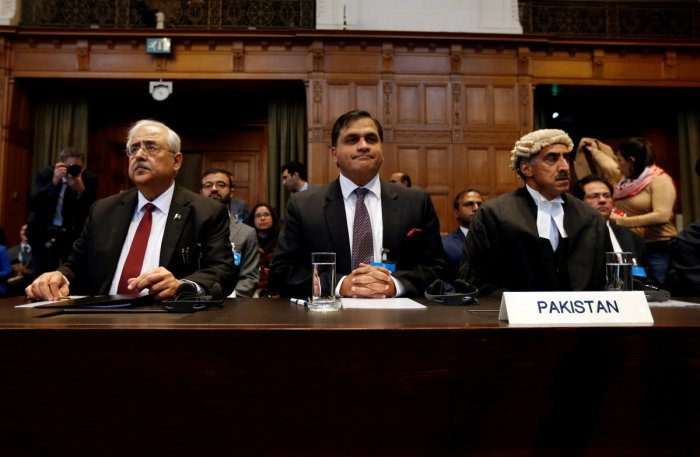(L-R) Attorney Anwar Mansoor Khan, Pakistani foreign office spokesperson Mohammad Faisal and Queen's Counsel Khawar Qureshi are seen at the International Court of Justice during the final hearing of the Kulbhushan Jadhav case in The Hague, the Netherlands