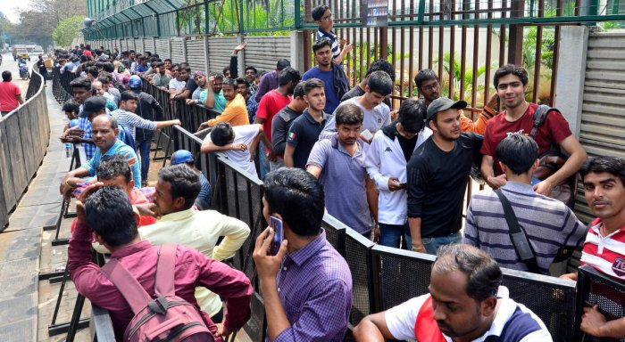 PASSION UNLIMITED Fans line up to buy tickets for the India-Australia T20 clash at the Chinnaswamy Stadium. DH PHOTO