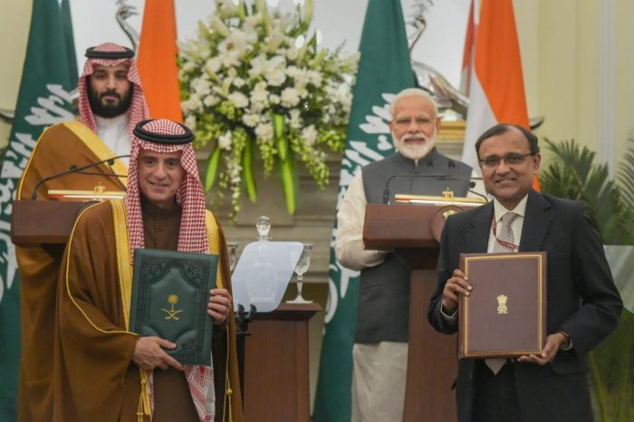 Prime Minister Narendra Modi and the Crown Prince of Saudi Arabia Prince Mohammed Bin Salman Bin Abdulaziz Al-Saud witness the exchange of MoU files between Secretary(ER) T S Tirumurti and Saudi Arabia's Minister of State for Foreign Affairs Adel Al-Jubeir, at Hyderabad House in New Delhi, Wednesday, February 20, 2019. (PTI Photo)