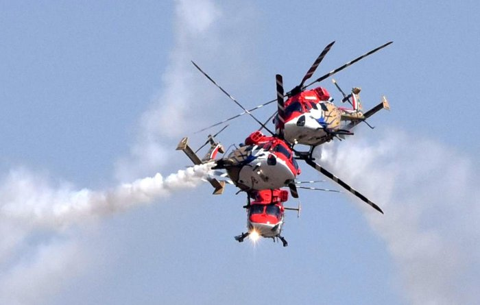 Sarang Helicopters performing at the inaugural of Aero India organised by Defence Ministry at Yalahanka Aerospace in Bengaluru on Wednesday. (DH Photo/S K Dinesh)