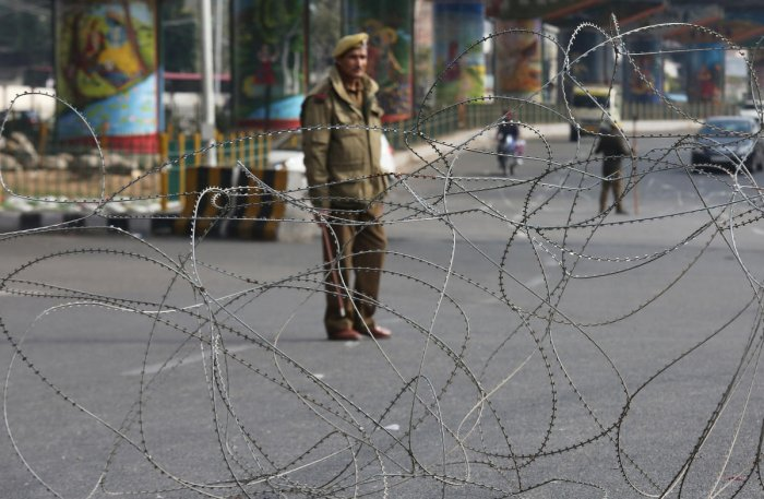 A policeman stands guard at a street in Jammu. Reuters file photo