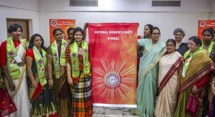 National Women's Party founder Shweta Shetty (4th from L) along with the party members unveils the party's symbol and flag for the upcoming Lok Sabha elections, in New Delhi on  Thursday. PTI