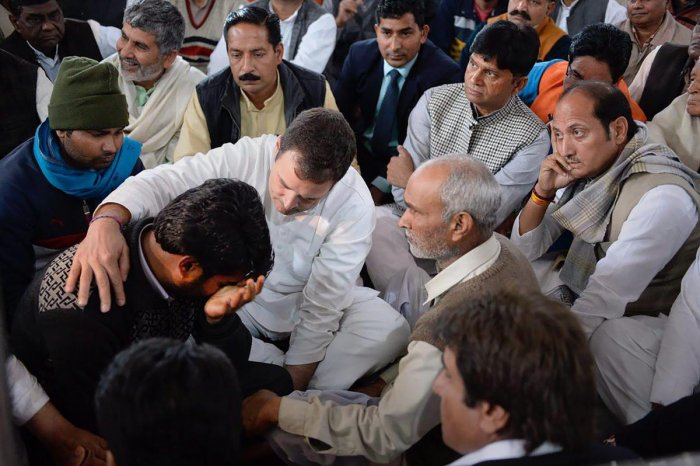 Congress president Rahul Gandhi meets the family members of the slain CRPF jawan Amit Kumar Kori, who lost his life in the Pulwama terror attack, at his residence in Shamli on Wednesday. (PTI Photo)