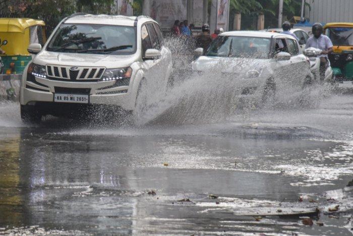 Vehicles on a flooded Kasturba Road on Sunday. DH FILE PHOTO/S K Dinesh
