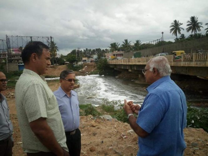 BBMP commissioner M Maheshwar Rao (left) along with officials inspect the bridge on Sunday.