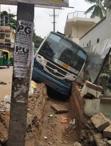 The BMTC bus that landed in an open drain in the Wilson Garden police station limits on Sunday morning.
