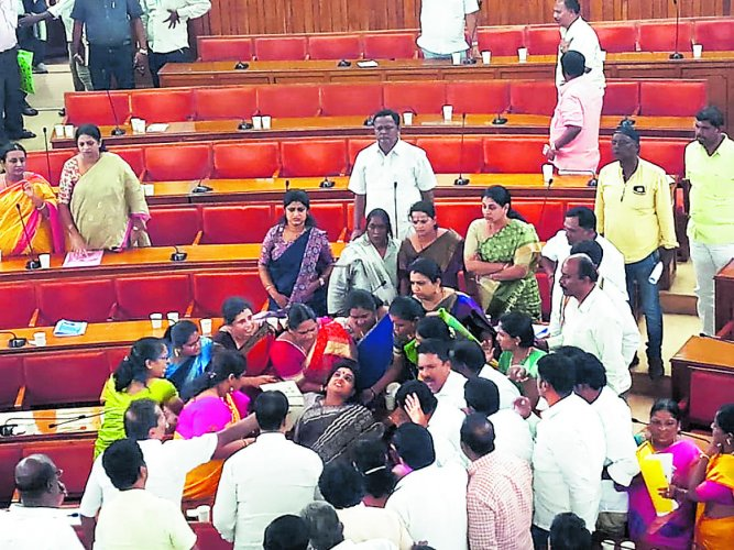 Congress corporator Roopa R faints at the BBMP council meeting on Friday.