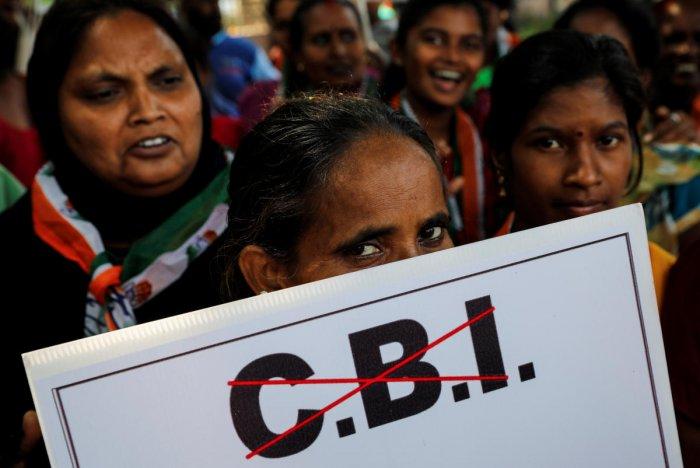Congress workers protest near the Central Bureau of Investigation (CBI) building in Mumbai. REUTERS