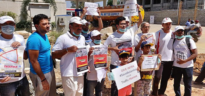 The residents of Bellandur region formed human chain demanding better infrastructure facilities from BBMP on Saturday.