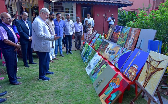 Dignitaries look at the paintings during the inauguration of Kadri Rocks, an art gallery, in Mangaluru.