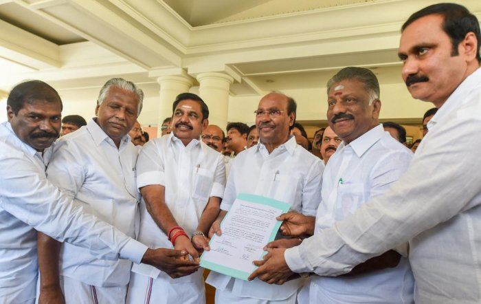Tamil Nadu Chief Minister Edappadi K Palaniswami, Deputy Chief Minister O Panneerselvam and senior leaders of AIADMK and PMK show a signed copy of alliance agreement for the upcoming Lok Sabha elections, in Chennai. PTI