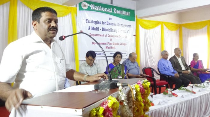 MLA M P Appachu Ranjan speaks at a workshop on 'Strategies for Disaster Management: A Multidisciplinary Approach', at Government First Grade College in Madikeri.