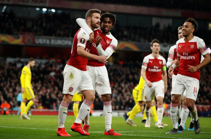 THUMPING HEADER: Arsenal's Shkodran Mustafi (left) celebrates with team-mates after scoring his side's second goal against BATE Borisov. Reuters