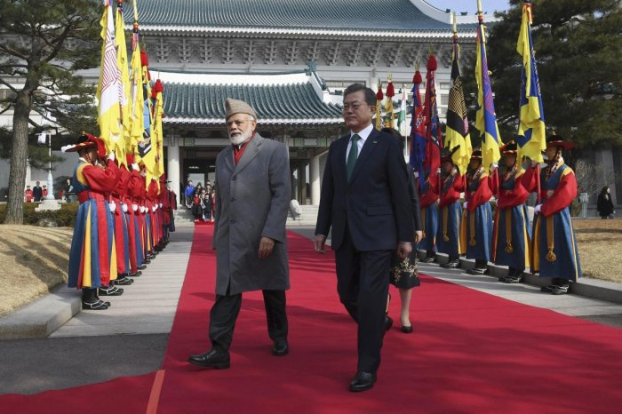 Indian Prime Minister Narendra Modi, left, and South Korea's President Moon Jae-in review honor guards during a welcoming ceremony at the presidential Blue House in Seoul Friday, Feb. 22, 2019. Modi is on a two-day visit to South Korea as part of an effor