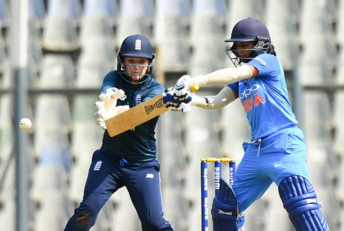 England's wicketkeeper Sarah Taylor (L) watches India's captain Mithali Raj play a shot during the first match of the women's one-day international (ODI) cricket series between India and England at the Wankhede Stadium in Mumbai on February 22, 2019. (AFP