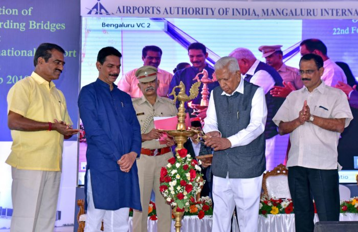 Governor Vajubhai Rudabhai Vala inaugurates a programme to lay foundation for terminal building expansion at Mangaluru International Airport on Friday.