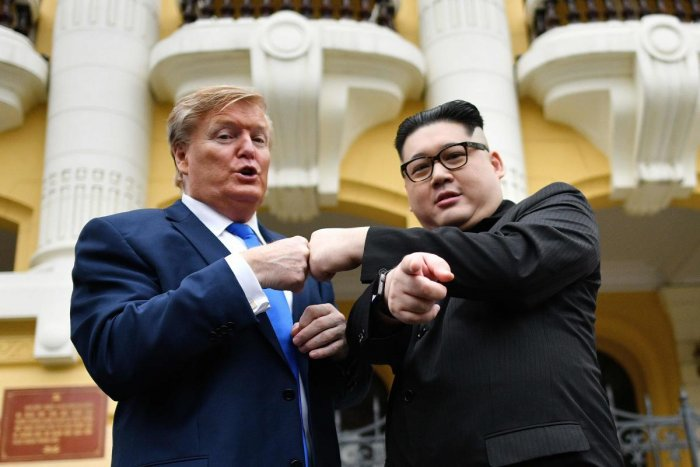 US President Donald Trump impersonator Russel White (L) and North Korean leader Kim Jong Un impersonator Howard X (R) pose together for photographs outside the Opera House in Hanoi on February 22, 2019. (AFP)